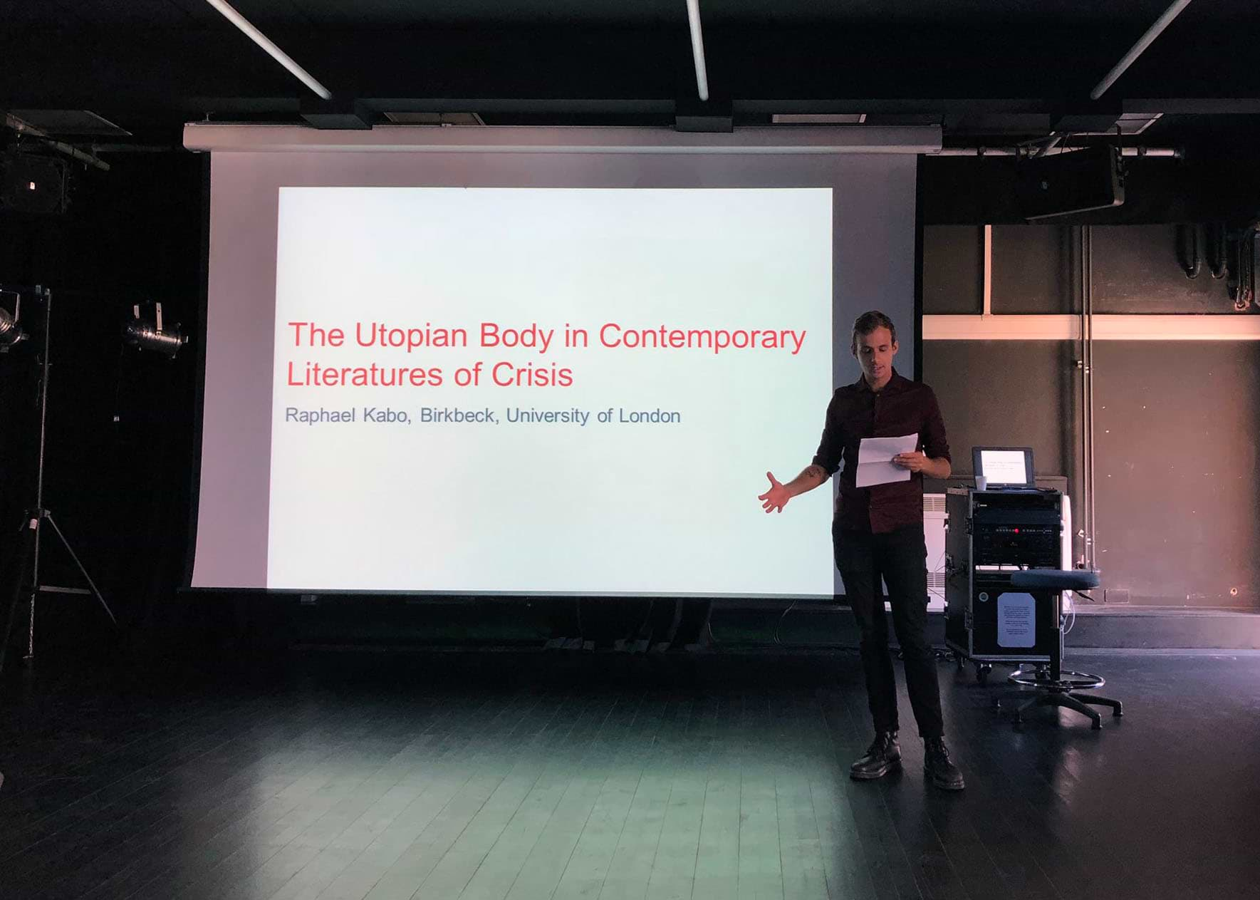 Photograph of me presenting my paper 'The Utopian Body in Contemporary Literatures of Crisis' at BACLS 2018, Loughborough University, UK. Photograph by Carly Robinson (@carlymarierobbo)